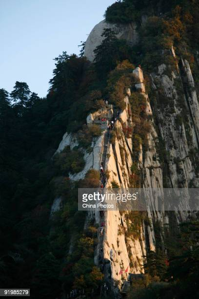 Tourists climb along the Canglong Ridge on the Huashan Mountain on October 18 2009 in Huayin Shaanxi Province China Huashan located at an altitude of...