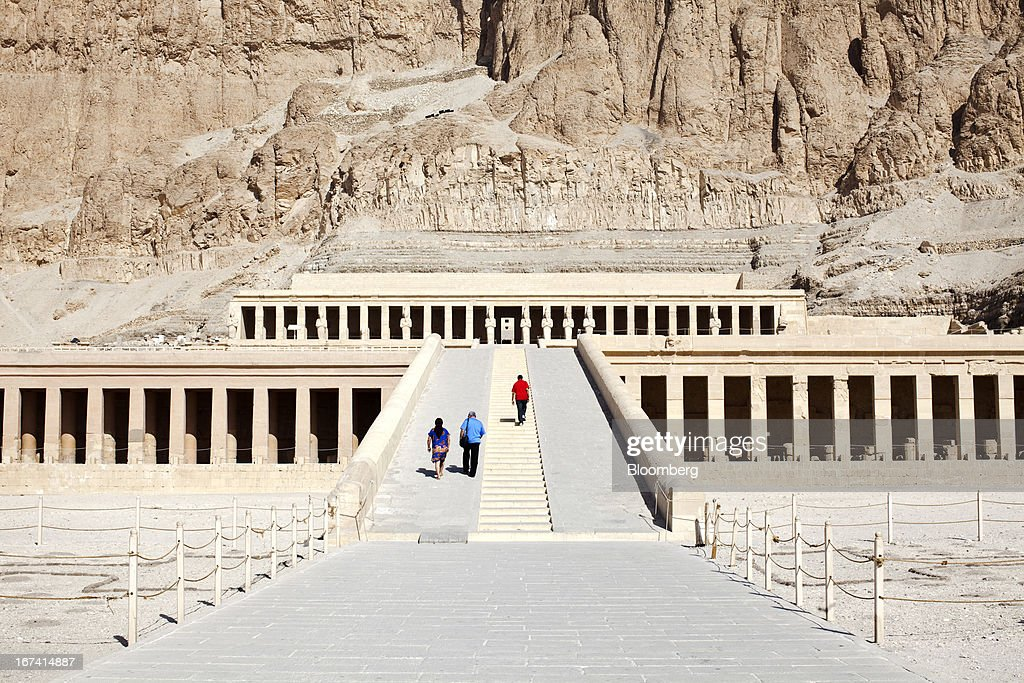 Tourists climb the steps at the approach to the Temple of Hatshepsut in Luxor, Egypt, on Wednesday, April 24, 2013. Egypt ranked last in terms of security and safety on the World Economic Forum's 2013 Travel and Tourism Competitiveness Index. Photographer: Shawn Baldwin/Bloomberg via Getty Images