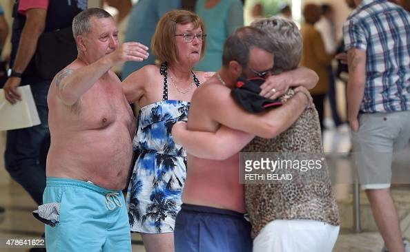 Tourists console each other following a shooting attack in the resort town of Sousse a popular tourist destination 140 kilometres south of the...
