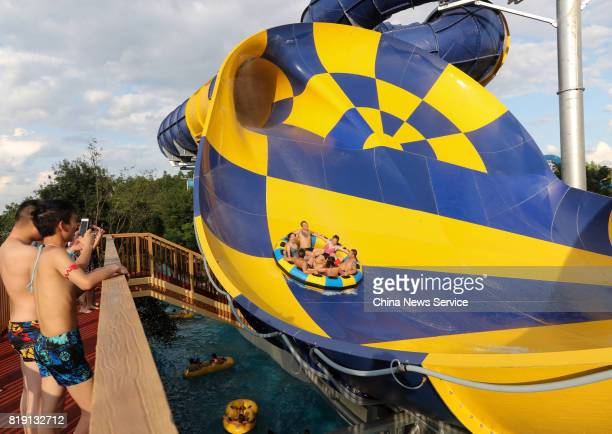 Tourists cool off at a water park on July 19 2017 in Wuhan Hubei Province of China The water park in Wuhan provides fun activities for tourists so...