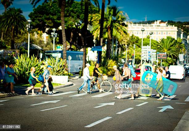 Tourists crossing a road in Nice, France