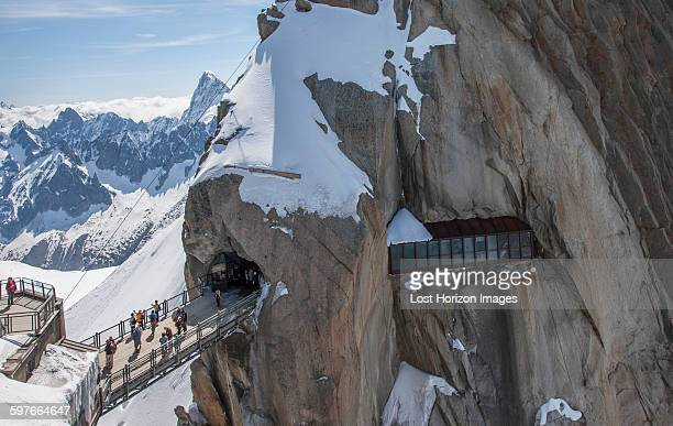 Tourists crossing bridge at Aguille du Midi, Mont Blanc, Chamonix, Haute Savoie, France