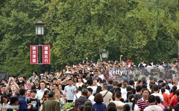 Tourists crowd at West Lake on the third day of National Day holiday on October 3 2017 in Hangzhou Zhejiang Province of China Around 710 million...