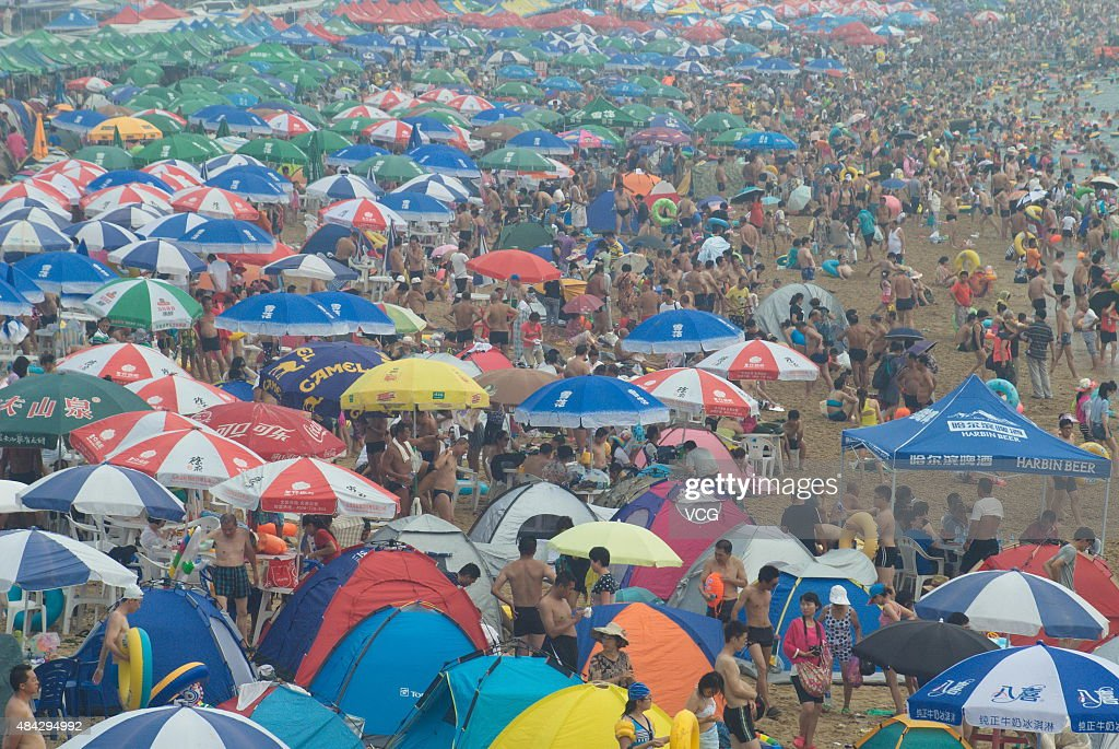 Tourists crowd onto Fujiazhuang beach to cool themselves as the temperature reaches 30 degrees on August 16 2015 in Dalian China