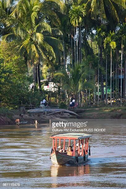 Tourists cruising the Mekong River, Don Det, Laos