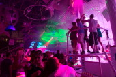 Tourists dance in a disco in Sant Antoni de Portmany on Spain's Ibiza Island early on July 4 2012 Sant Antoni de Portmany is the second largest city...