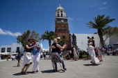 Tourists dance in Teguise's main square during the Street Market on April 13 2014 in Lanzarote Spain Lanzarote where British Prime Minister David...