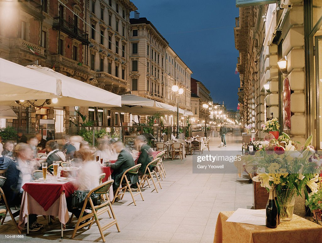 Tourists dining outside restaurants
