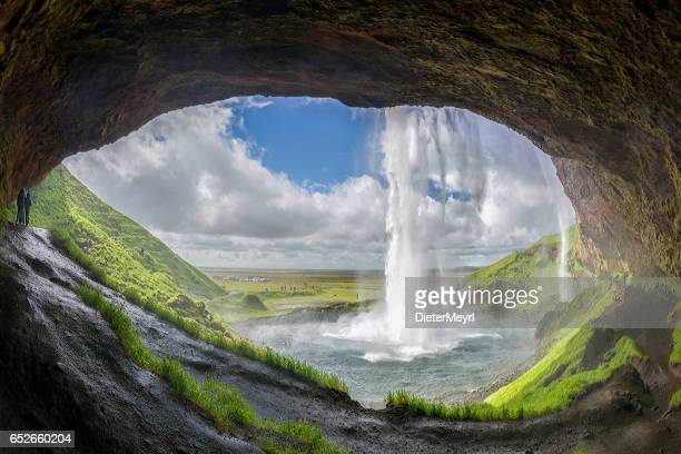 Tourists discover the Seljalandsfoss waterfall