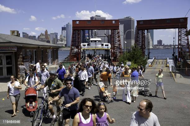 Tourists disembark from a ferry boat July 17 2011 to Governors Island across New York Harbor at the tip of lower Manhattan Control of the 22acre...
