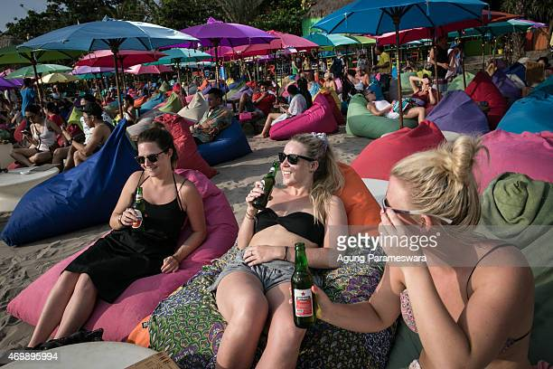 Tourists drink Bintang beers at Double Six beach on April 16 2015 in Seminyak Bali Indonesia Indonesia on April 16 banned small retailers from...