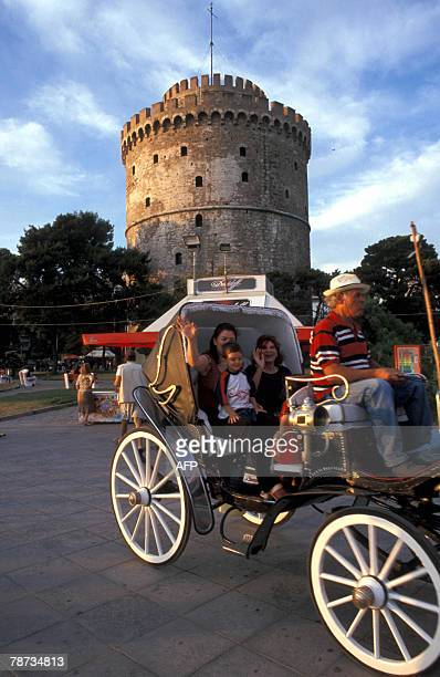 Tourists drive past the White Tower in Thessaloniki at this undated file picture The White Tower a 15th century monument that is the best known...