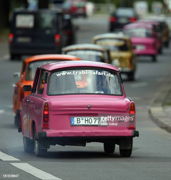 Tourists drive Trabant cars on a guided tour through the city center on September 19 2013 in Berlin Germany Several companies now offer tours with...