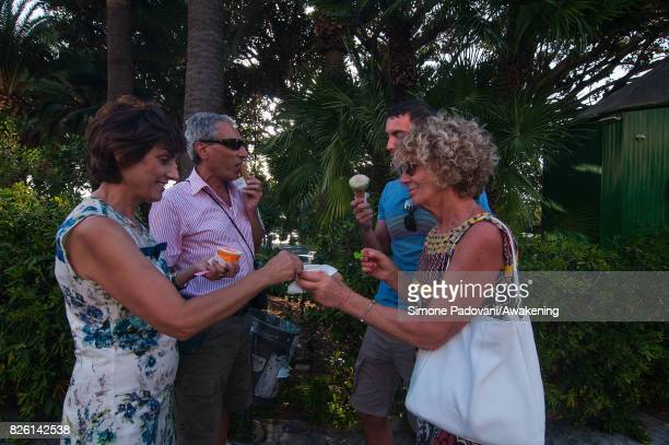 Tourists eat icecream to cool off from the heat on August 03 2017 in Reggio Calabria Italy An intense heatwave is sweeping across many regions of...