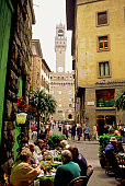 Tourists eating at sidewalk cafe, Palazzo Vecchio, Florence, Italy