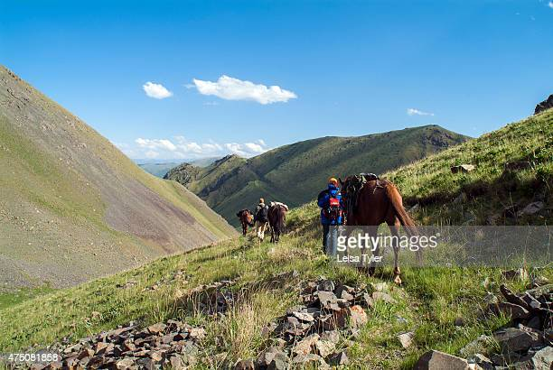Tourists en route to Lake Song Kol across the mountains of central Kyrgyzstan Sitting over 2000 meters and covered in snow in winter in summer the...