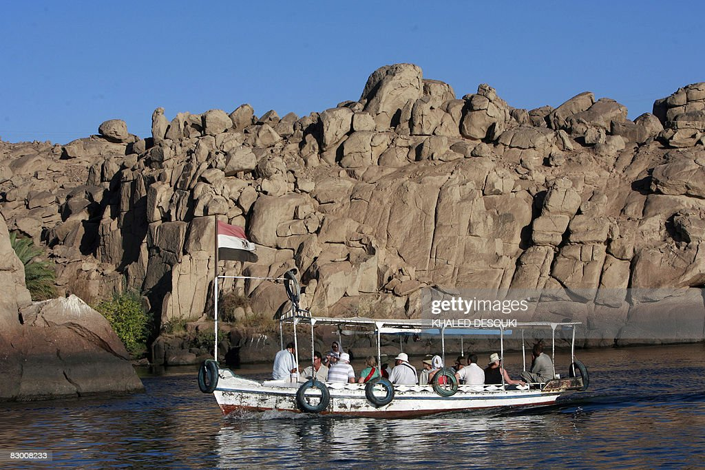 Tourists enjoy a boat ride in the Nile close to the Elephantine island in the River Nile, off the southern town of Aswan, 800 kms south of the Egyptian capital Cairo, on September 25, 2008. The kidnapping of 11 Europeans in Egypt's southern desert will barely dent the country's lucrative tourist industry which seems to bounce back faster after each attempt to damage it, experts say. The group of five Germans, five Italians and a Romanian as well as eight Egyptian drivers and guides was snatched by masked bandits while on a desert safari to view prehistoric art in Egypt's remote southwest last Friday.