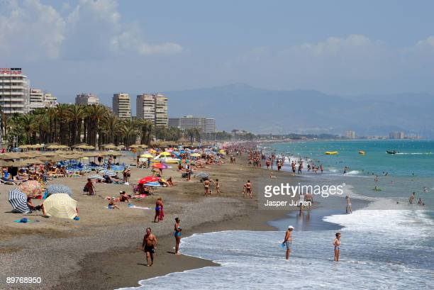 Tourists enjoy a usually packed Costa del Sol Carihuela beach on August 12 2009 in Torremolinos Spain Altough Spanish resorts remain busy receiving...