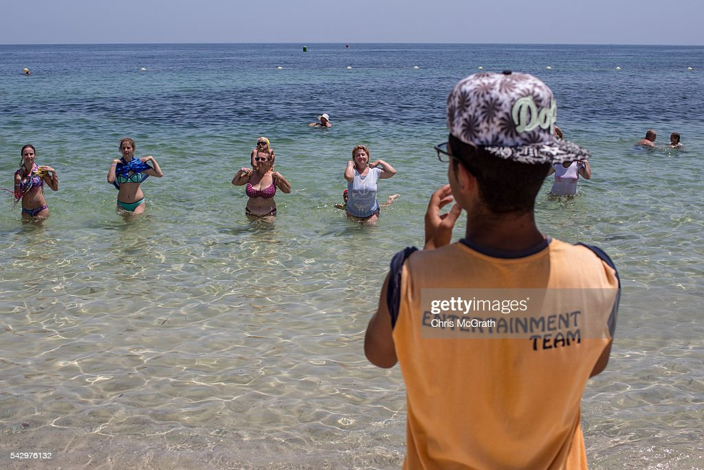 Tourists enjoy a water aerobics class at the beach on June 25, 2016 in Sousse, Tunisia. Before the 2011 revolution, tourism in Tunisia accounted for approximately 7% of the countries GDP. The two 2015 terrorist attacks at the Bardo Museum and Sousse Beach saw tourism numbers plummet even further forcing hotels to close and many tourism and hospitality workers to lose their jobs. The 26th of June marks the first anniversary of the Sousse beach attacks.