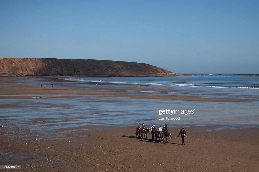 Tourists enjoy Donkey rides on Filey Beach on March 2, 2013 in Filey, England. The Met office have predicted the warmest day of the year on March 5, with a top temperature of 15 degrees in some parts of the country.