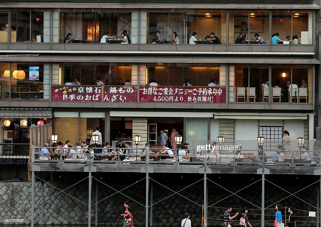 Tourists enjoy food at outdoor summer restaurants at Kawaramachi on July 5, 2014 in Kyoto, Japan. Kyoto has been named the world's best city in the U.S. magazine Travel + Leisure for 2014, according to its website. The former capital of Japan is known for old temples and shrines.