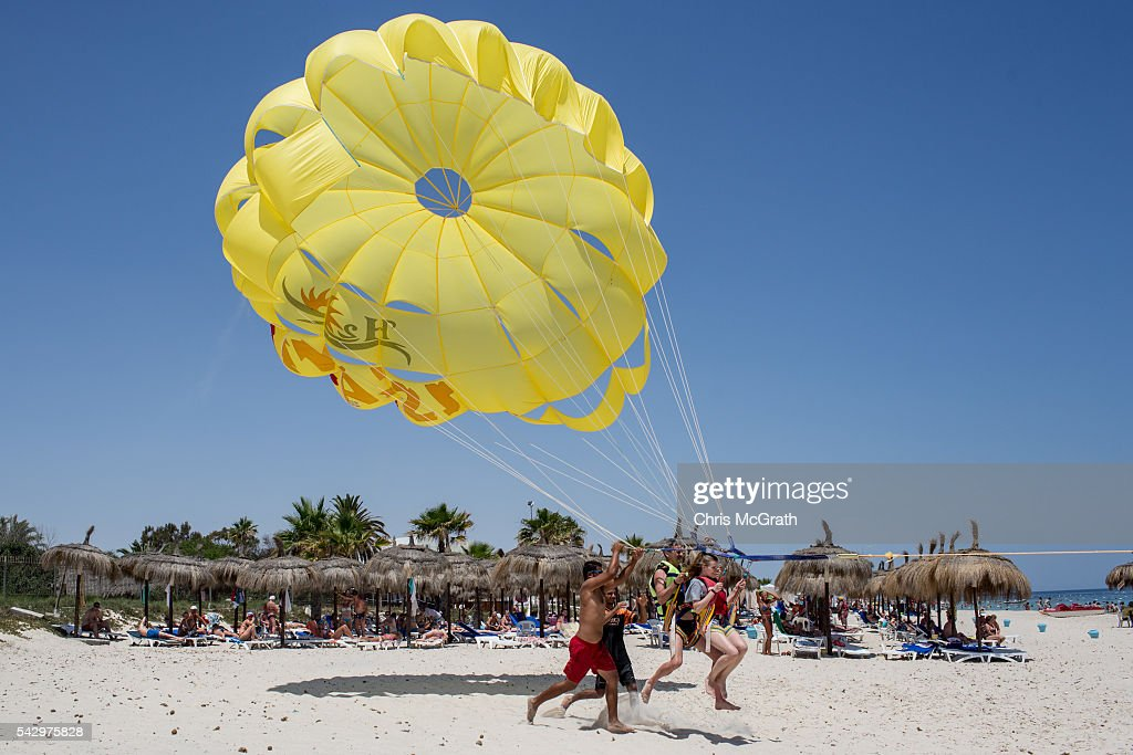 Tourists enjoy parasailing on June 25, 2016 in Sousse, Tunisia. Before the 2011 revolution, tourism in Tunisia accounted for approximately 7% of the countries GDP. The two 2015 terrorist attacks at the Bardo Museum and Sousse Beach saw tourism numbers plummet even further forcing hotels to close and many tourism and hospitality workers to lose their jobs. The 26th of June marks the first anniversary of the Sousse beach attacks.
