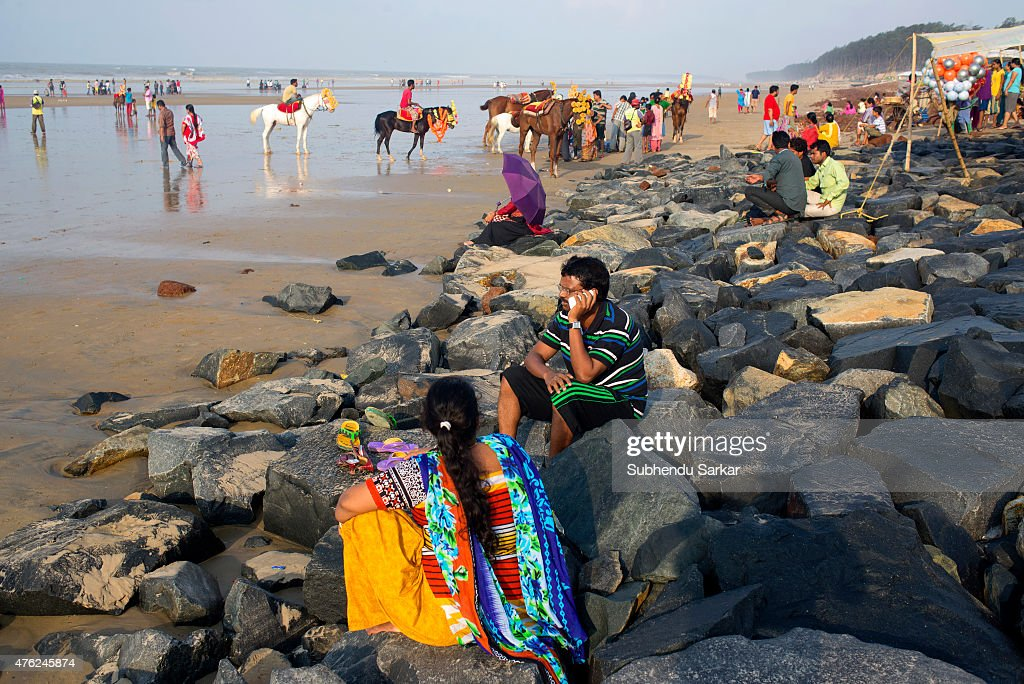 Tourists enjoy sitting at sea beach in Digha Digha in East Midnapore district of West Bengal is a seaside resort town about 187 kms from Kolkata It...