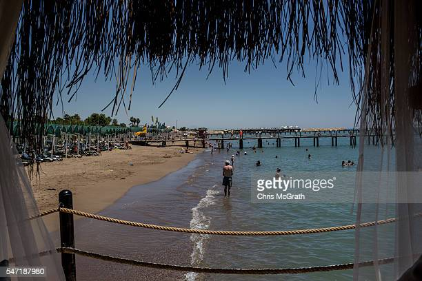 Tourists enjoy the beach at a resort on July 12 2016 in Antalya Turkey Russian President Vladimir Putin last month officially lifted travel...
