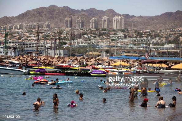 Tourists enjoy the beach in the Red Sea Israeli resort city of Eilat on August 19 2011 Eight Israelis were killed in a string of attacks in the south...