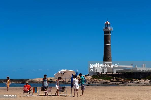 Tourists enjoy the beach near the lighthouse of Jose Ignacio next to Punta del Este one of the most exclusive seaside resorts of Latin America 140 km...