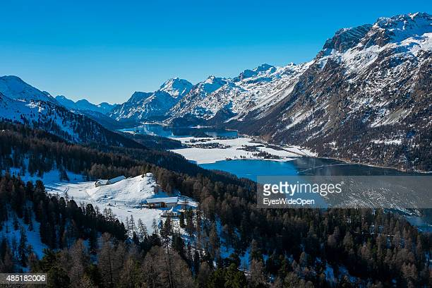 Tourists enjoy the panoramic landscape view on Lake Silvaplana from the ski area Piz Corvatch with its cable car up to the glacier on December 14...