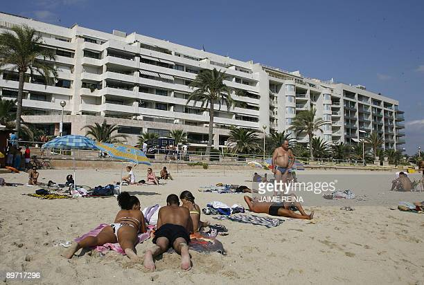 Tourists enjoy the sun at Can Pere Antoni's beach Palma de Mallorca on August 9 2009 A bomb exploded today in a restaurant following a telephoned...