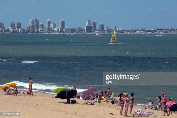Tourists enjoy the sun in La Mansa beach of Punta del Este one of the most exclusive seaside resorts of Latin America 140 km east from Montevideo on...