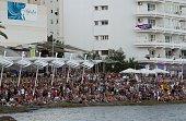Tourists enjoy the sunset at Cafe del Mar in San Antonio de Portmany on Ibiza Island on July 10 2015 AFP PHOTO/ JAIME REINA