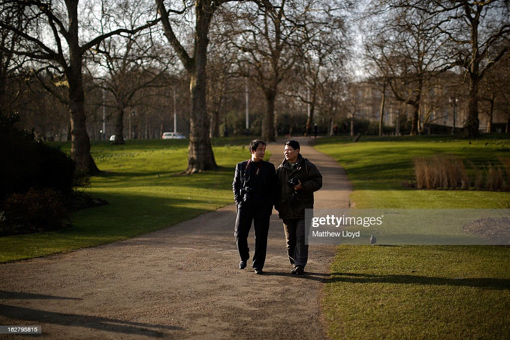 Tourists enjoy the sunshine in St James' Park on February 27, 2013 in London, England. The Met Office has predicted a cold period at Easter.