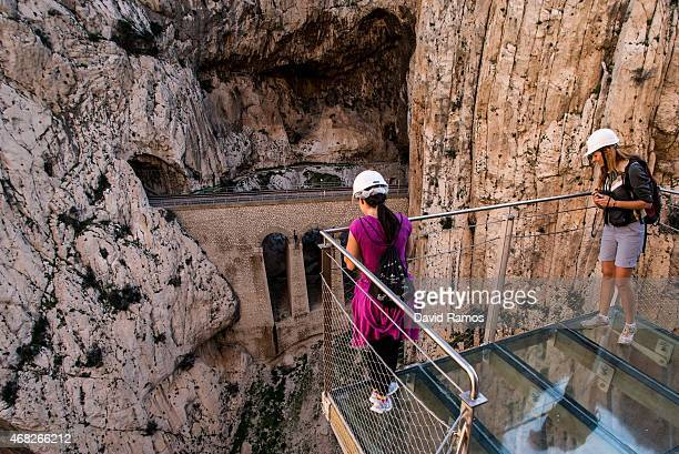Tourists enjoy the view from the 'El Caminito del Rey' footpath on April 1 2015 in Malaga Spain 'El Caminito del Rey' which was built in 1905 and...