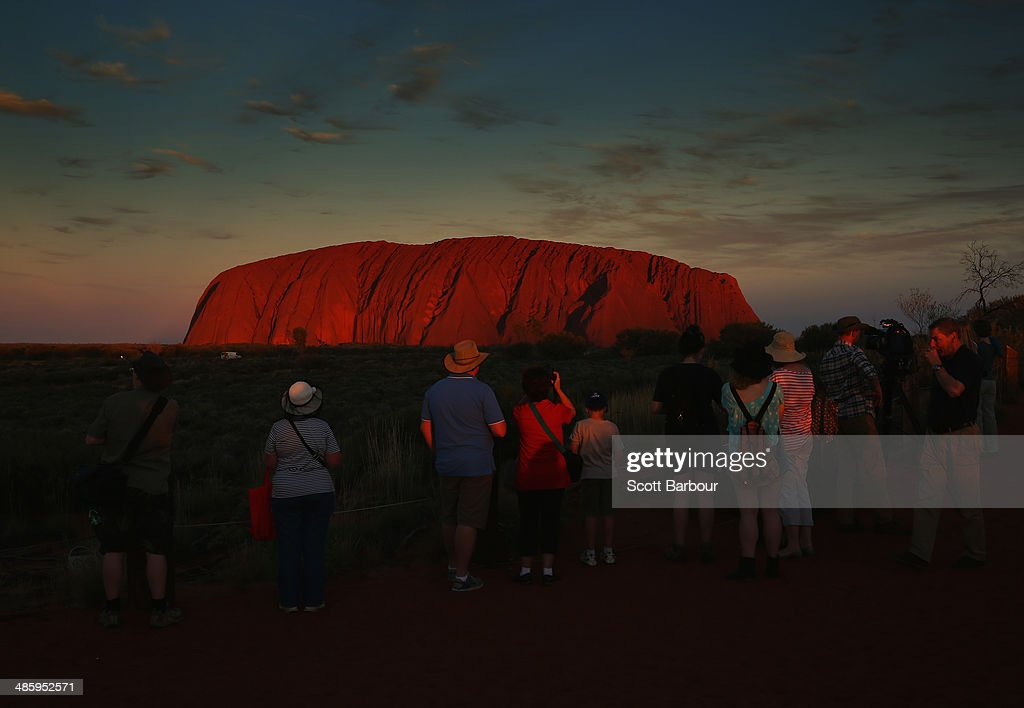 Tourists enjoy the view of Uluru, also known as Ayers Rock at sunset on April 21, 2014 in Ayers Rock, Australia. The Duke and Duchess of Cambridge are on a three-week tour of Australia and New Zealand, the first official trip overseas with their son, Prince George of Cambridge.