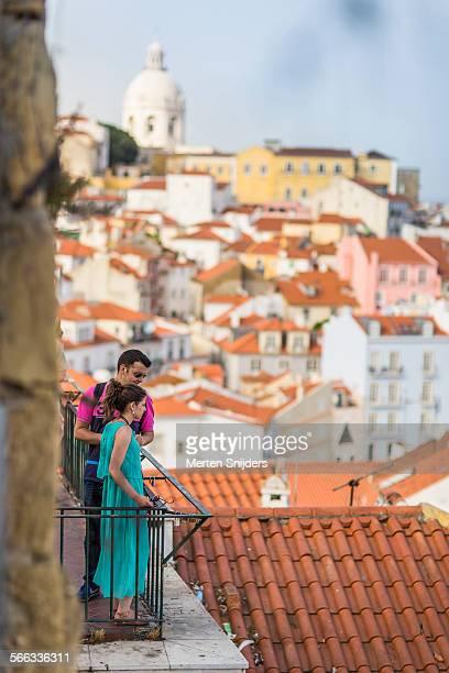 Tourists enjoying Alfama views from deck