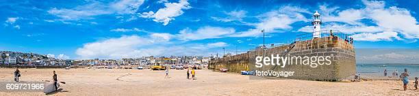 Tourists enjoying beach harbour seaside resort St Ives panorama Cornwall
