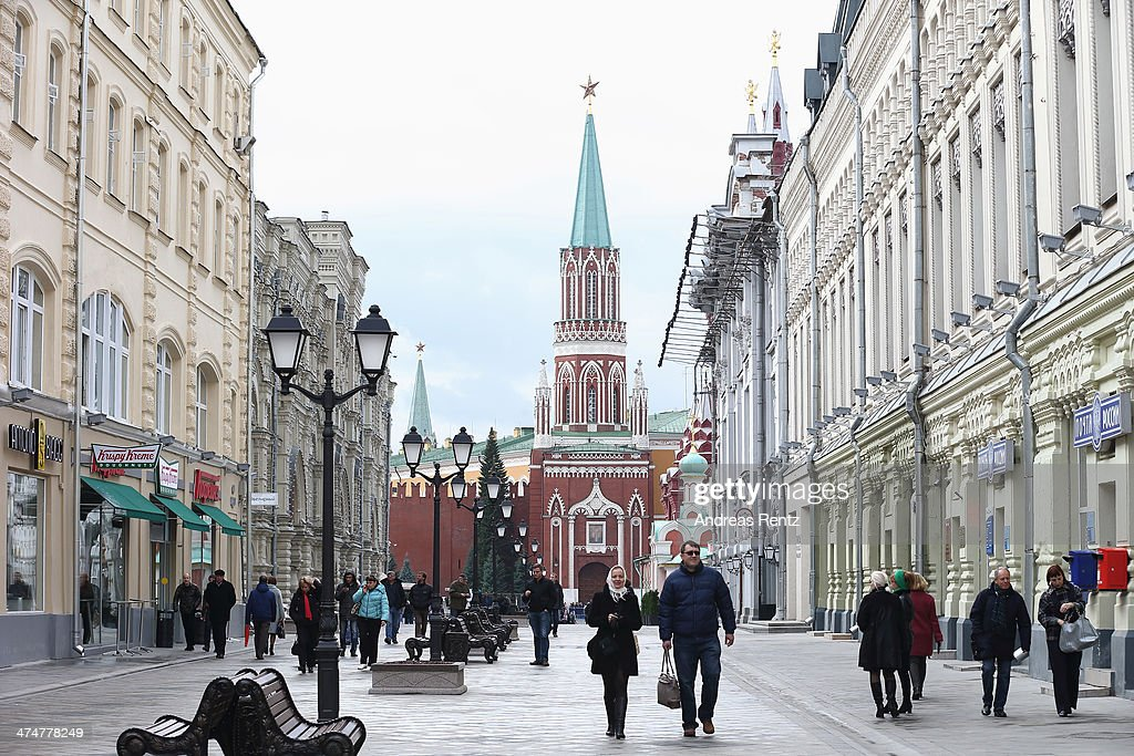 Tourists explore a shopping street near gates of Kremlin on October 31 2013 in Moscow Russia