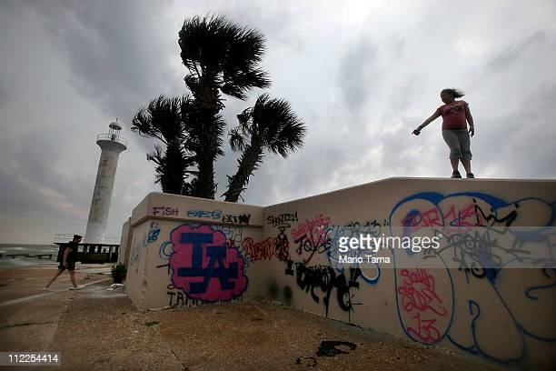 Tourists explore in front of the Biloxi Lighthouse on the Gulf of Mexico April 15 2011 in Biloxi Mississippi BP says it has made tourism payments of...