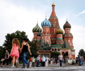 Tourists explore Red Square in front of St Basil's Cathedral ahead of the 14th IAAF World Athletics Championships on August 6 2013 in Moscow Russia