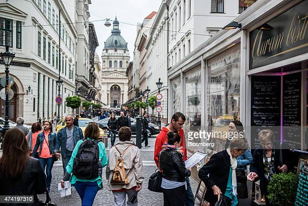 Tourists explore the area surrounding St Stephen's basilica in central Budapest Hungary on Friday May 15 2015 Housing in Hungary is on the mend after...
