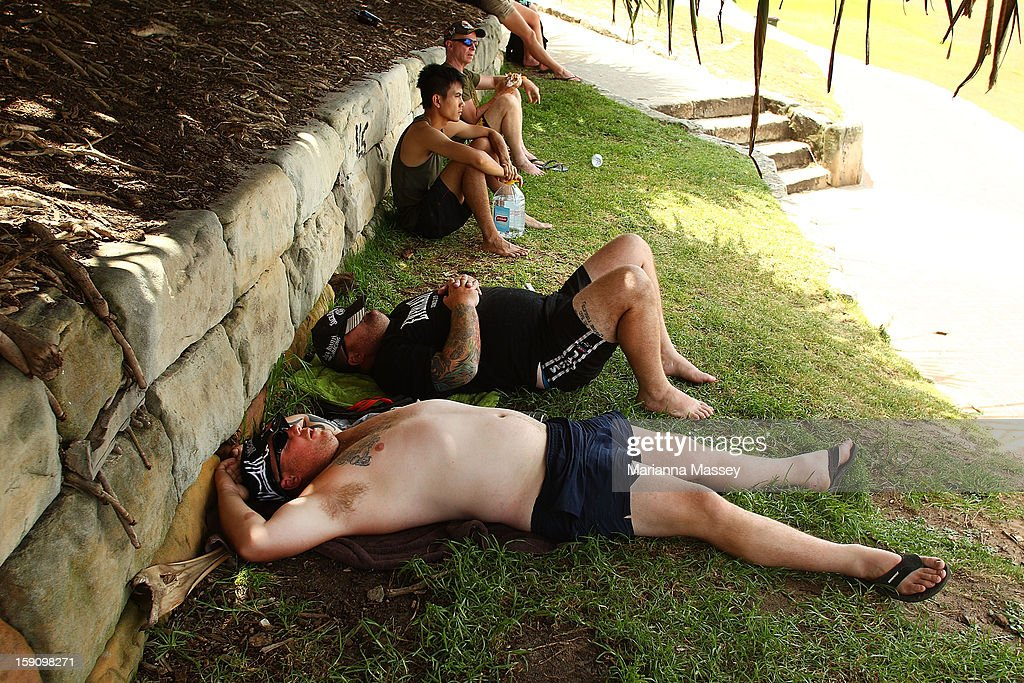 Tourists find a patch of shade to rest in at Bondi Beach on January 8, 2013 in Sydney, Australia. Temperatures are expected to reach as high as 43 degrees around Sydney today.
