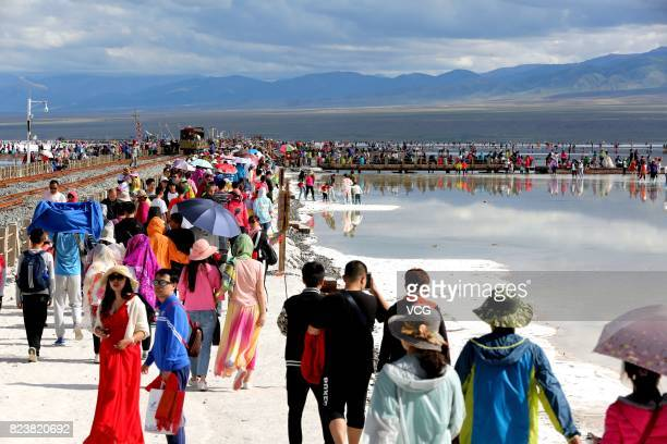 Tourists flock to Chaka Salt Lake at Chaka Town on July 27 2017 in Haixi Mongolian and Tibetan autonomous Prefecture Qinghai Province of China Chaka...