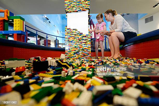 Tourists from Brisbane Australia Rebecca Ludcke and her daughter Kate play with Lego toys in the lobby of North America's first ever Legoland Hotel...