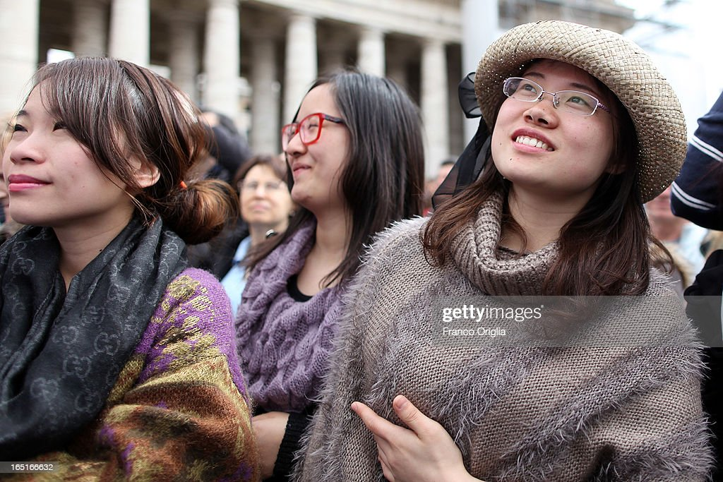 Tourists from China gather in St. Peter's Square attend the Regina Coeli Prayer held by Pope Francis on April 1, 2013 in Vatican City, Vatican.