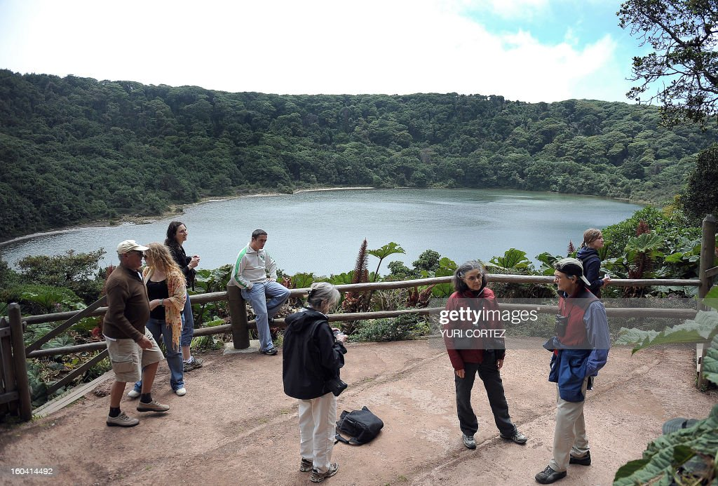 Tourists from different coutries visit the Botos Lagoon at the Poas Volcano National Park in Alajuela, some 40 kilometers from San Jose, on February 11, 2010. Botos Lagoon is an extinct volcanic crater filled by rainwater. It still contains traces of acidity due to its origin. Only a few microorganisms and algae can live in it. Its name derives from an indigenous tribe that used to live near to the lagoon called 'The Botos'. AFP PHOTO/ Yuri CORTEZ /