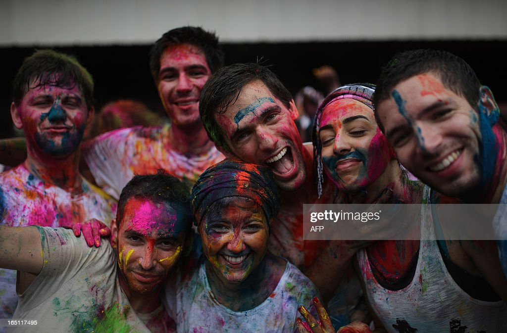 Tourists from France pose covered with coloured powder as they join the celebrations to mark 'Holi' at a temple in Kuala Lumpur on March 31, 2013. Holi, the festival of colours where people smear each other with coloured powder and water, is celebrated by Hindus across the country.