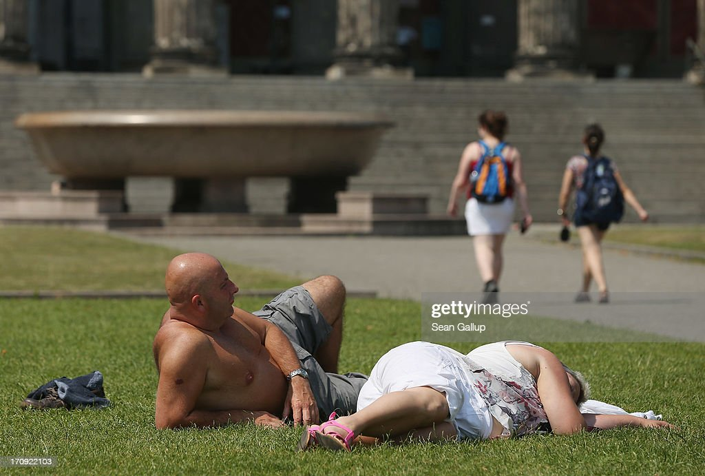 Tourists from Great Britain lie in the sun on a scorching hot summer day in the city center on June 20, 2013 in Berlin, Germany. Central Europe is in the grips of a heat wave in which temperatures in some regions have reached up to 38 degrees celsius.